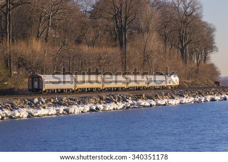 SCARBOROUGH, NEW YORK, USA - February 2004: Metro North commuter train railroad line, on Hudson River. - stock photo