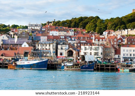 Scarborough, North Yorkshire, England - August 24, 2014: View over Scarborough South Bay harbor.The town has fishing and service industries and is the largest holiday resort on the Yorkshire coast, UK