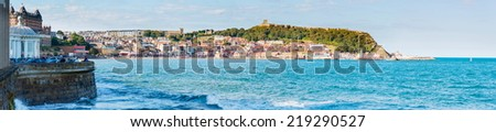 Scarborough, North Yorkshire, England - August 24, 2014: View over Scarborough South Bay harbor,UK.The town has fishing and service industries and is the largest holiday resort on the Yorkshire coast