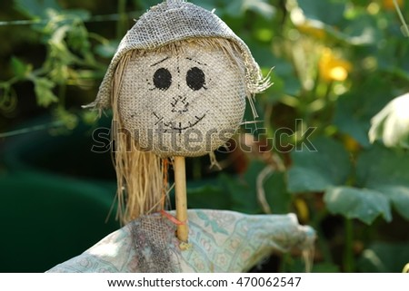 Scarecrow wearing a hat and a smile
