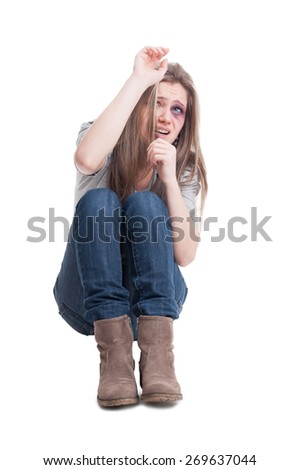 Scared and beaten female protecting herself isolated on white background - stock photo