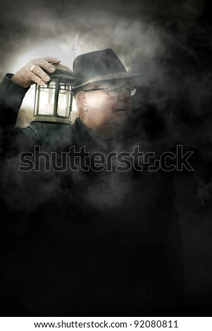 Scared And Terrified Old Man Holding A Candle Light Walking Around A Dark Misty Forest During The Dead Of Night In A Spine-Tingling Horror Scene - stock photo