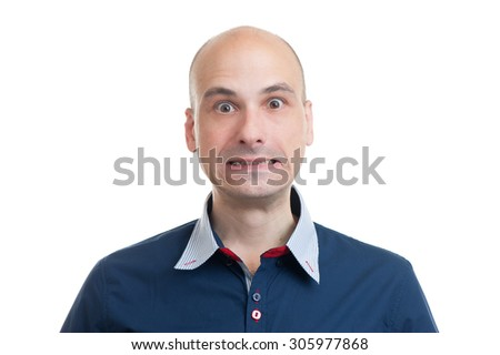 scared bald man wearing a blue shirt. Isolated on white background - stock photo