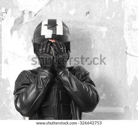 scared biker covering face