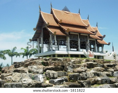 scared buddhist temple on the rocks - stock photo
