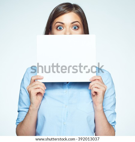 Scared business woman hide face with white sign board. Isolated portrait.