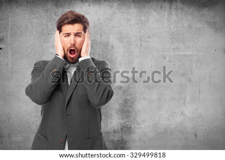 scared businessman covering ears - stock photo