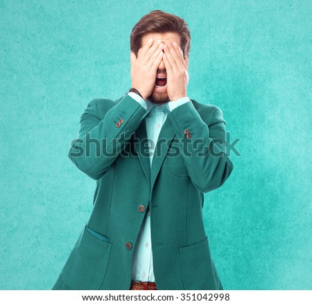 scared businessman covering eyes - stock photo