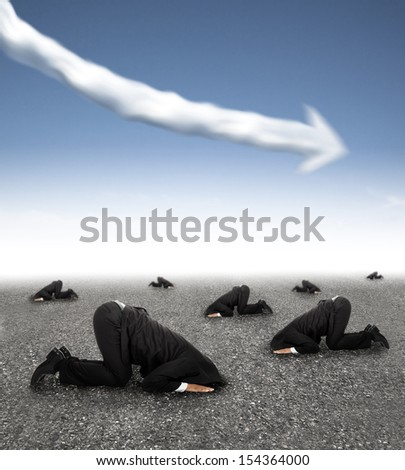 scared businessman hiding on the ground with business graph down concept - stock photo