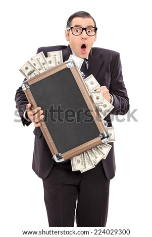 Scared businessman holding a briefcase full of money isolated on white background - stock photo