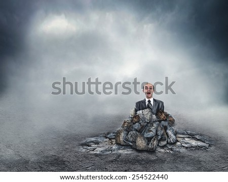 Scared businessman in the soil - stock photo