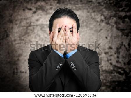 Scared businessman portrait - stock photo