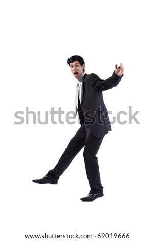 Scared businessman walking (isolated on white) - stock photo