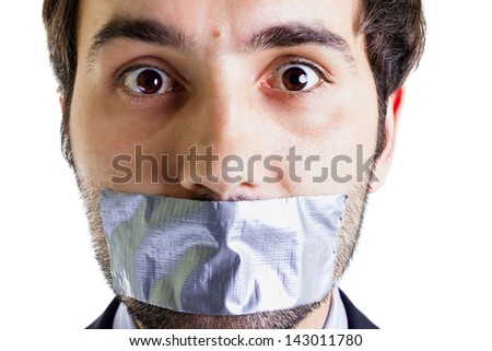 Scared businessman with duct tape on mouth, white background. Conceptual image. - stock photo