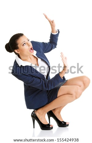 Scared businesswoman defending herself, isolated on white background - stock photo