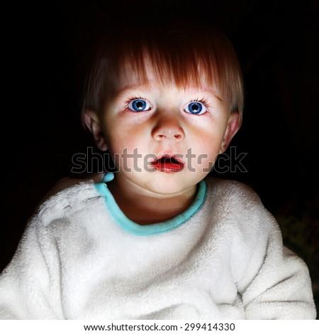 Scared Child Boy Portrait in the Dark Room - stock photo