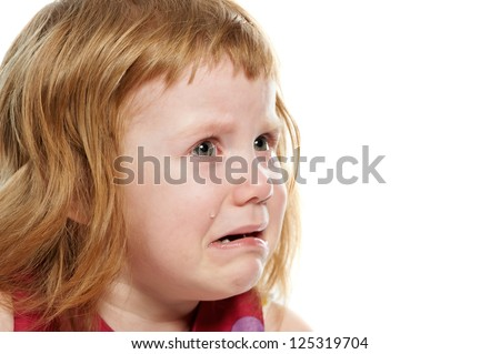 Scared crying little girl with tears on her cheeks - stock photo