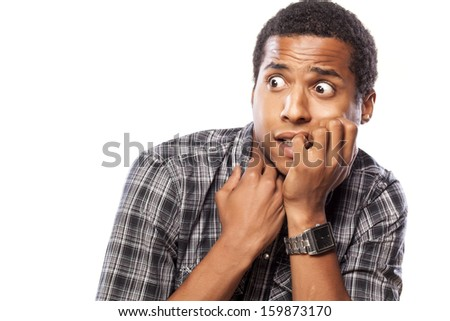 scared dark-skinned young man posing on white background - stock photo