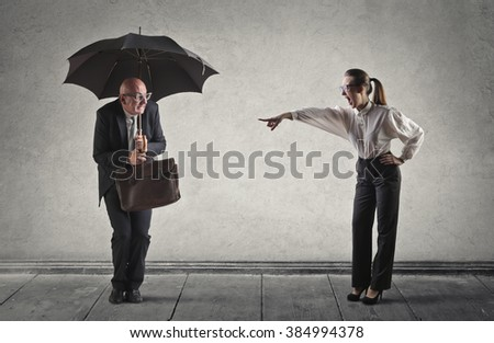 Scared employee being fired - stock photo