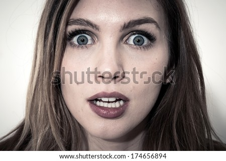 Scared face of women on white background - stock photo