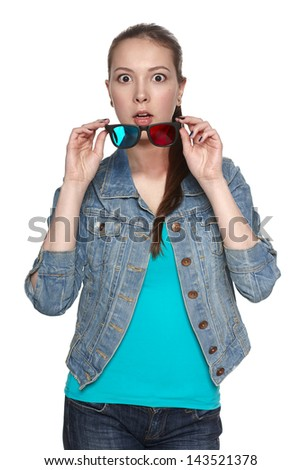 Scared female in three-dimensional eyeglasses with widely opened eyes, against white background