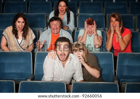 Scared group of people scream out in theater - stock photo