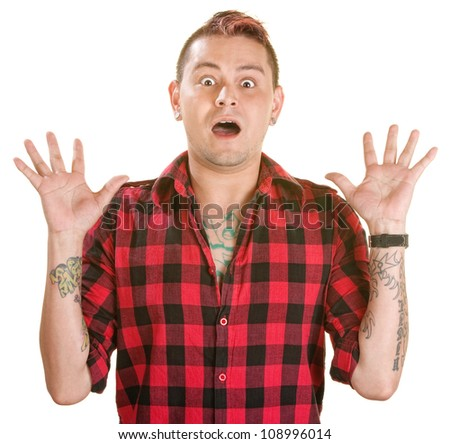 Scared Hispanic man with spiky dyed hair over white - stock photo