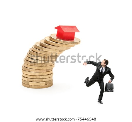 Scared investor running away from falling real estate prices isolated on white background - stock photo
