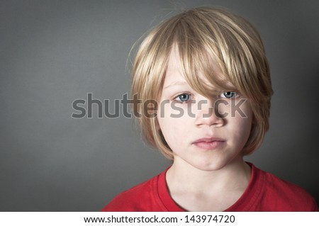 Scared little boy - stock photo
