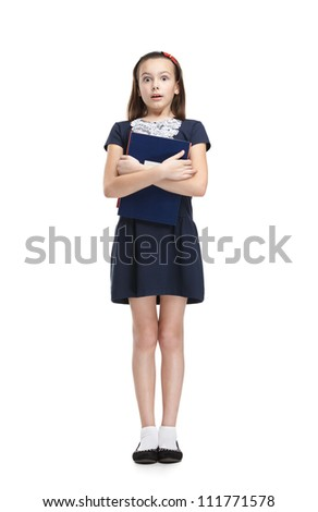 Scared schoolgirl carries her books, isolated, white background - stock photo