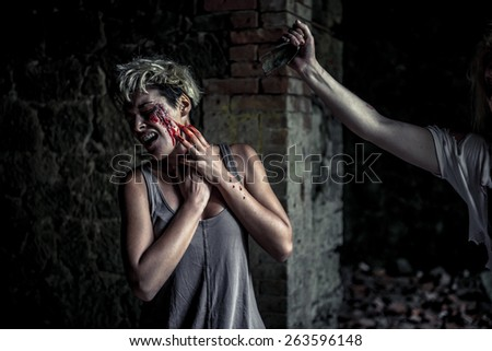 Scared woman, violence against her - stock photo