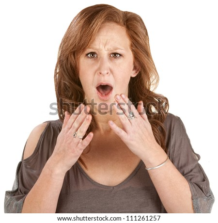 Scared woman with hands near face over white background