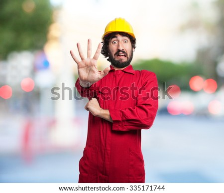 scared worker man stop gesture - stock photo