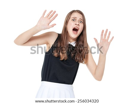 Scared young beautiful teenage girl screaming isolated on white background - stock photo