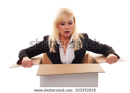Scared young blonde getting out from a box isolated on white - stock photo