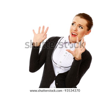 Scared young businesswoman gesturing on white background - stock photo