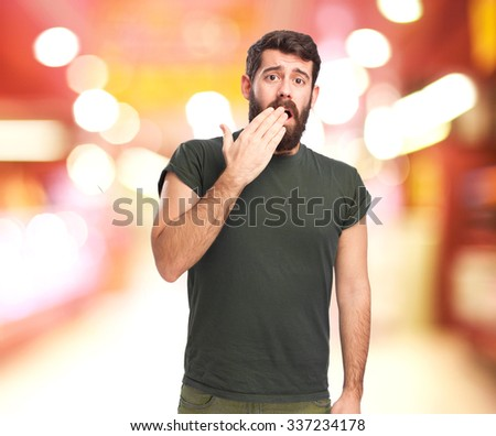 scared young man covering mouth - stock photo