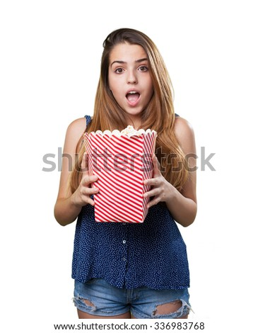 scared young woman holding popcorn - stock photo