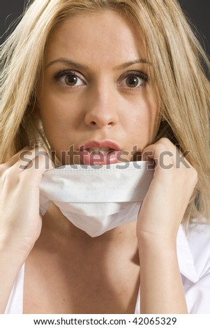 scared young woman with medical mask