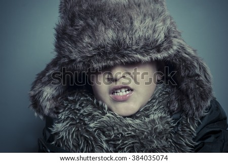 Scarf, Sad child with fur hat and winter coat, cold concept and storm