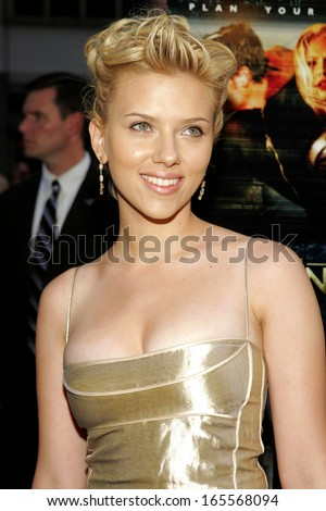 Scarlett Johansson, wearing Cartier earrings, at THE ISLAND Premiere, The Ziegfeld Theater, New York, NY, July 11, 2005 - stock photo