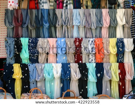 scarves on a store window. Street trading - stock photo