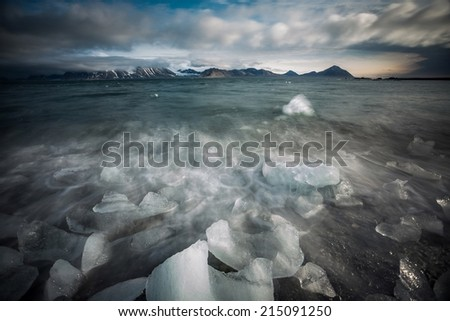 Scary Arctic landscape with ice on the beach (long exposure) - stock photo