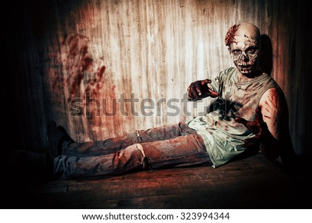 Scary bloody zombie man in the old house. Horror. Halloween.  - stock photo