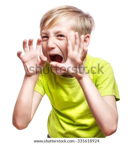 Scary boy using fingers to scare - stock photo