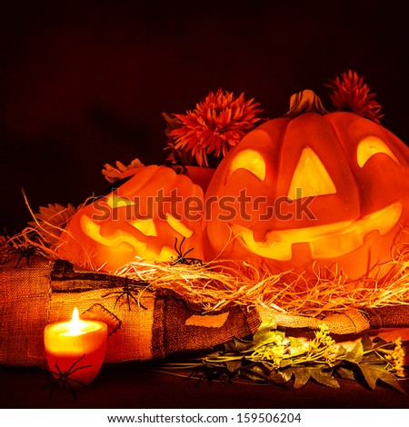Scary carved glowing pumpkin Halloween, terrible festive decoration, jack-o-lantern,  frightening party decor, horror concept - stock photo