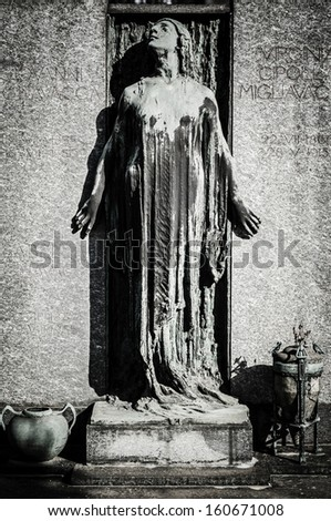scary cemetery statue horror death - stock photo