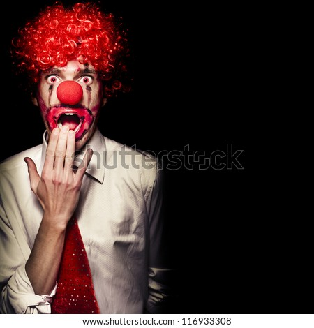 Scary Clown With Shocked Expression Isolated On Black Background.