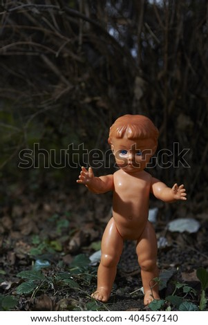 Scary doll. Child abuse. Crime scene. Lost - stock photo