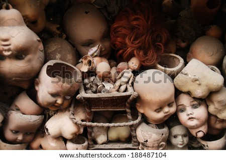 Scary doll's heads (with some white dust spots) - stock photo